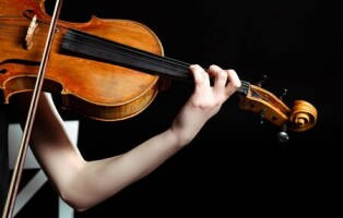 148353137-cropped-view-of-female-musician-playing-on-violin-isolated-on-black